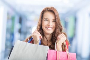 Beautiful Happy Girl With Credit Card And Shopping Bags In Shopp